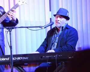 Buzzy on keys and vocals