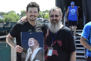 Artist/Photographer presents Minke Zito with a pic of Johnny Winter.